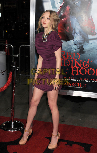 "AMANDA SEYFRIED.""Red Riding Hood"" Los Angeles Premiere held at Grauman's Chinese Theatre, Hollywood, California, USA,.7th March 2011..arrivals full length short-sleeve purple jewels necklace diamante striped pink burgundy maroon dress beige nude shoes ankle strap .CAP/ROT/TM.© TM/Roth/Capital Pictures"