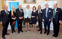 30 October 2017 - Prime Minister Theresa May with Adil Ray, Billy Connolly, Jane Asher, Gerald Scarfe, Pamela Stephenson, Paul Mayhew-Archer and Steve Ford, CEO Parkinsonís UK at a reception at 10 Downing Street in London, marking 200 years since Dr James Parkinson's Essay on the Shaking Palsy. Photo Credit: ALPR/AdMedia
