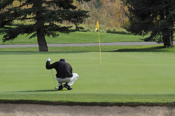 Man putting on golf course, Colorado
