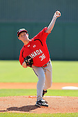 Team Canada Clayton Isherwood #36 delivers a pitch during a game vs the Nexen Heroes at Al Lang Field in St. Petersburg, Florida;  February 28, 2011.  Canada defeated Nexen 2-0.  Photo By Mike Janes/Four Seam Images