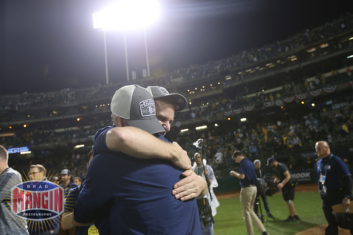 OAKLAND, CA - OCTOBER 02:  Matt Duffy #5 of the Tampa Bay Rays celebrates with Willy Adames #1 on the field after the American League Wild Card Game against the Oakland Athletics at RingCentral Coliseum on Wednesday, October 2, 2019 in Oakland, California. (Photo by Brad Mangin)