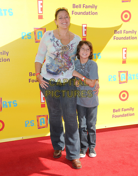 "CAMRYN MANHEIM & son MILO.at The 12th Annual P.S. ARTS ""Express Yourself 2009"" To Help Restore Arts Education in Public Schools,The event was  held at Barker Hangar in Santa Monica, California, USA, .November 15th 2009..full length blue print top dragon mother mom mum family child kid  jeans                                                     .CAP/RKE/DVS.©DVS/RockinExposures/Capital Pictures."