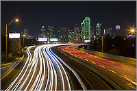 This Dallas Skyline image is taken from a place you probably do not want to venture to alone. Still, the view from the overpass looking over Interstate 30 into downtown Dallas is a nice place photograph the Dallas cityscape. I lingered here for only a few minutes, taking several long exposure (about 20 seconds each) to allow the traffic lights to light up the highway. In the distance are some of the iconic Dallas highrises, and the colorful ball of Reunion Tower is on the far right.