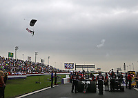 Apr 26, 2015; Baytown, TX, USA; A sky diver parachutes into Royal Purple Raceway with an American flag prior to NHRA top fuel driver Leah Pritchett racing during the Spring Nationals. Mandatory Credit: Mark J. Rebilas-