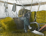 Jerome ID:  Homesteader repairing equipment in the temporary tent next to the farmhouse - 1909.  Brady Stewart and three friends went to Idaho on a lark from 1909 thru early 1912.  As part of the Mondell Homestead Act, they received a grant of 160 acres north of the Snake River.  Brady Stewart photographed the adventures of farming along with the spectacular landscapes. To give family and friends a better feel for the adventure, he hand-color black and white negatives into full-color 3x4 lantern slides.  The Process:  He contacted a negative with another negative to create a positive slide.  He then selected a fine brush and colors and meticulously created full color slides.