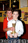 Proud aunt Bridie Roche of the Sportsfield bar, Tralee with her 11 year old nephew, Ciaran Keogh (Dublin) after he won the U11 title in An Comhdhail World Irish Dance Championships in the INEC last weekend,