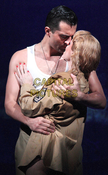 Darius Campbell, Rebecca Thornhill<br /> 'From Here to Eternity' new musical theatre photocall,  Shaftesbury Theatre, London, England, UK, October 16th 2013.<br /> music acting on stage half length costume <br /> CAP/ROS<br /> &copy;Steve Ross/Capital Pictures
