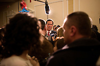Members of the media and public speak with former Senator Rick Santorum at the Hillsborough County Republican Gala at the Crowne Plaza Hotel in Nashua, New Hampshire, on Jan. 6, 2012. Former congressmen Rick Santorum and Newt Gingrich spoke at the event. Both are seeking the 2012 Republican presidential nomination.