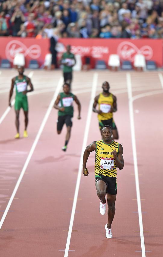 Jamaica's Usain Bolt during the men's 4x100m relay heat 2<br /> <br /> Photographer Chris Vaughan/CameraSport<br /> <br /> 20th Commonwealth Games - Day 9 - Friday 1st August 2014 - Athletics - Hampden Park - Glasgow - UK<br /> <br /> © CameraSport - 43 Linden Ave. Countesthorpe. Leicester. England. LE8 5PG - Tel: +44 (0) 116 277 4147 - admin@camerasport.com - www.camerasport.com