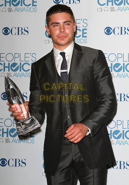 ZAC EFRON.2011 People's Choice Awards held at Nokia Theatre L.A. Live, Los Angeles, California, USA..January 5th, 2011.half length grey gray suit award trophy winner  .CAP/ADM/KB.©Kevan Brooks/AdMedia/Capital Pictures.