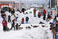 Saturday March 6 , 2010   Ryan Redington takes the turn from 4th Avenue onto Cordova Street as spectaors line the snow berms in downtown Anchorage during the ceremonial start of the 2010 Iditarod