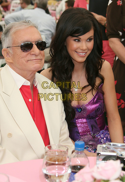 HUGH HEFNER &  JAYDE NICOLE.2008 Playmate of the Year Luncheon held at the Playboy Mansion, Holmby Hills, California, USA, 08 May 2008..half length sitting at table Ray Ban aviator sunglasses.CAP/ADM/RE.©Russ Elliot/Admedia/Capital PIctures