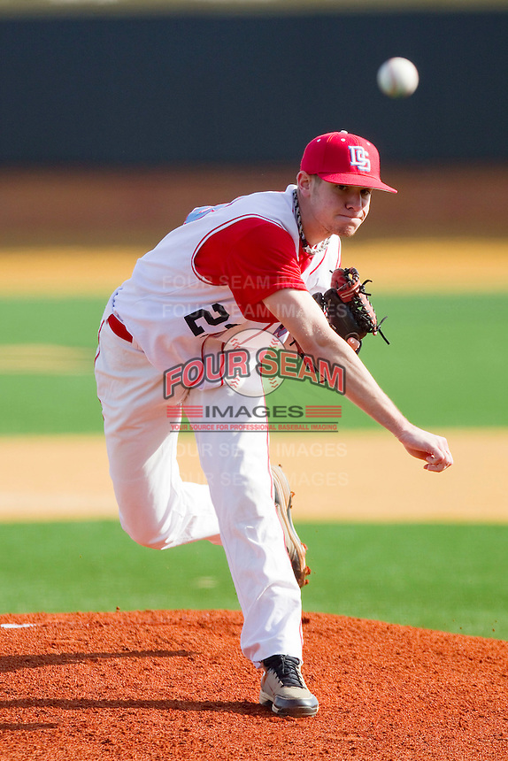 Starting pitcher Matt McClain #23 of the Delaware State Hornets in action against the Georgetown Hoyas at Gene Hooks Field on February 26, 2011 in Winston-Salem, North Carolina.  Photo by Brian Westerholt / Four Seam Images