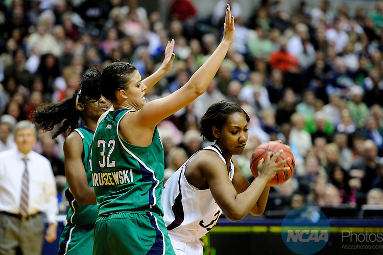 05 APR 2011: Karla Gilbert (34) of Texas A&M and Becca Bruszewski (32) of Notre Dame battle for the ball during the Division I Women's Basketball Championship held at Conseco Field in Indianapolis, IN. Texas A&M defeated the University of Notre Dame 76-70 to claim the national title. Stephen Nowland/NCAA Photos