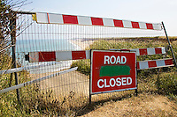 Road Closed sign in front of eroded shoreline road on Norfolk Coast, United Kingdom