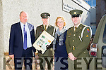 Members of the Defence Forces Lt Denis Sheahan and Gunner Mark Coffey arrived with the Irish flag and the proclamation at Moyderwell Primary on Tuesday to  commemorate the 100 year anniversary and were welcomed by Chairman Board of Management Cllr Jim Finucane and Principal Moire Quinlan