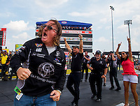 Sep 7, 2015; Clermont, IN, USA; NHRA sponsor Josh Comstock (left) and top fuel team owner Bob Vandergriff (center) celebrate after driver Dave Connolly advanced to the final round to clinch a playoff spot during the US Nationals at Lucas Oil Raceway. Mandatory Credit: Mark J. Rebilas-USA TODAY Sports