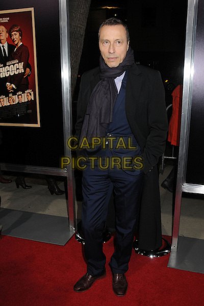 """Michael Wincott.""""Hitchcock"""" Los Angeles Premiere held at the AMPAS Samuel Goldwyn Theater, Beverly Hills, California, USA..November 20th, 2012.full length blue suit black coat trenchcoat scarf hands in pockets .CAP/ADM/BP.©Byron Purvis/AdMedia/Capital Pictures."""