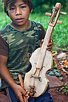 Son of Angel Morinigo, an Mbya Guarani craftsman and musician from Andresito village near San Ignacio, Misiones, Argentina, with a handmade Guarani 3-string violin (rabe).