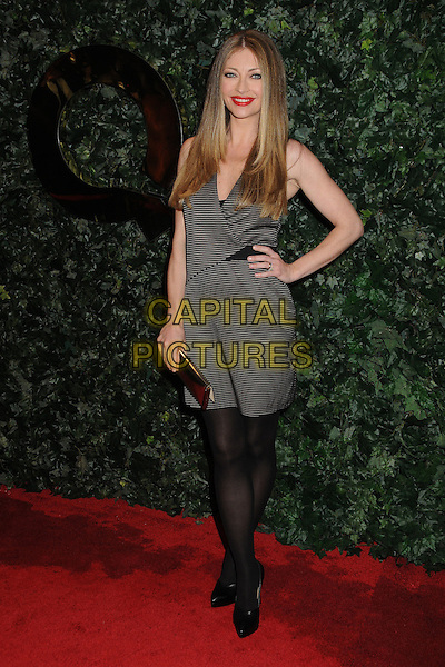 REBECCA GAYHEART.QVC Red Carpet Style Party held at the Four Seasons Hotel, Beverly Hills, California, USA..February 25th, 2011.full length black tights grey gray dress clutch bag hand on hip stripe.CAP/ADM/BP.©Byron Purvis/AdMedia/Capital Pictures.