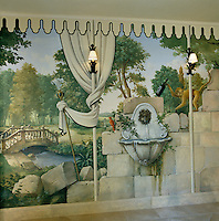 A detail of a dining room mural shows a monkey climbing with a bottle of wine in its hand and a view of a pastoral landscape