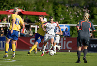 Carli Lloyd (11) controls the ball against Sweden's Lotta Schelin (8) during the match against Sweden, Landskamp, Sweden, July 5th, 2008.