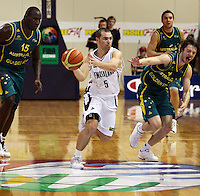 Tall Blacks guard Mike Fitchett looks to pass after beating (from left) Nathan Jawai, Adam Gibson and Matthew Dellavedova during the International basketball match between the NZ Tall Blacks and Australian Boomers at TSB Bank Arena, Wellington, New Zealand on 25 August 2009. Photo: Dave Lintott / lintottphoto.co.nz