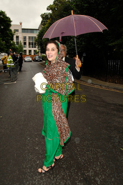 BENAZIR BHUTTO.David Frost's Summer Garden Party.5th July London, England.full length umbrella green sari leopard print scarf wrap .CAP/PL.©Phil Loftus/Capital Pictures