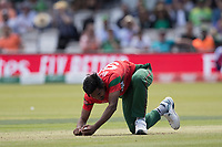 Mustafizur Rahman (Bangladesh) picks himself up after taking a return catch during Pakistan vs Bangladesh, ICC World Cup Cricket at Lord's Cricket Ground on 5th July 2019