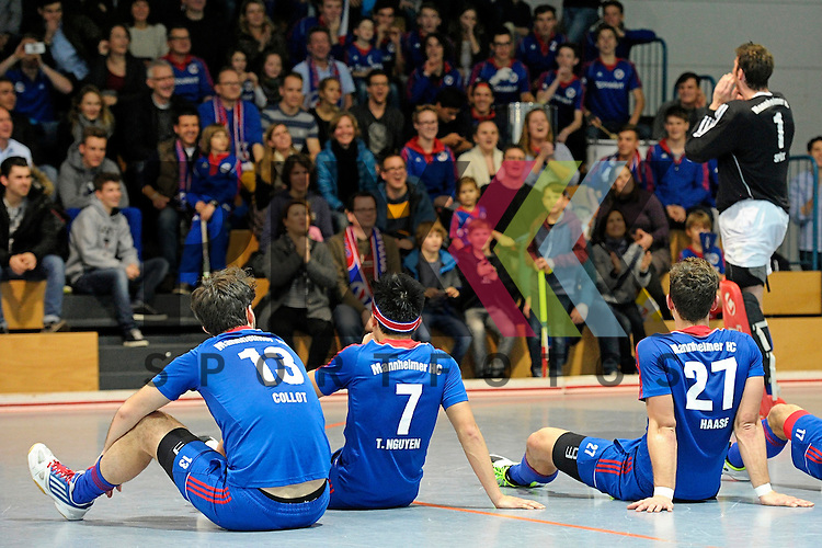 GER - Mannheim, Germany, December 12: Players of Mannheimer HC celebrate after winning the derby against TSV Mannheim on December 12, 2015 at Irma-Roechling-Halle in Mannheim, Germany. Final score 5-0 (HT 1-0).  (r) Andreas Spaeck #1 of Mannheimer HC<br /> <br /> Foto &copy; PIX-Sportfotos *** Foto ist honorarpflichtig! *** Auf Anfrage in hoeherer Qualitaet/Aufloesung. Belegexemplar erbeten. Veroeffentlichung ausschliesslich fuer journalistisch-publizistische Zwecke. For editorial use only.