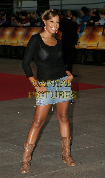 SU-ELISE NASH.At The Goal Film Premiere held at the Odeon Cinema,.Leicestre Square,.London, 15th September 2005.full length brown cowboy boots short denim skirt black top.Ref: AH.www.capitalpictures.com.sales@capitalpictures.com.© Capital Pictures.