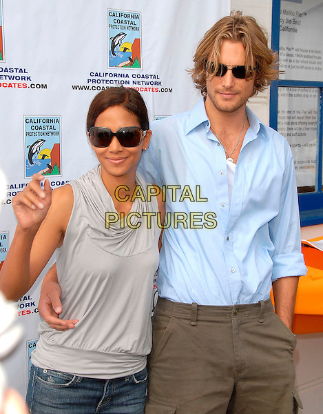 HALLE BERRY & GABRIEL AUBRY.participate in the protest at A Day at the Beach and Paddle Out Protest against the proposed Liquid Natural Gas Facility Construction held at Malibu Surfrider Beach in Malibu, California, USA, October 22th 2006..half length sunglasses grey sleeveless top cowel neck hand.Ref: DVS.www.capitalpictures.com.sales@capitalpictures.com.©Debbie VanStory/Capital Pictures