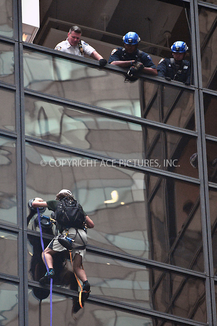 www.acepixs.com<br /> <br /> August 10 2016, New York City<br /> <br /> A man was seized by members of the NYPD as he climbed the outside of Trump Tower on Fifth Avenue on August 10 2016 in New York City.<br /> <br /> By Line: Curtis Means/ACE Pictures<br /> <br /> <br /> ACE Pictures Inc<br /> Tel: 6467670430<br /> Email: info@acepixs.com<br /> www.acepixs.com