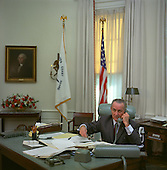 United States President Lyndon B. Johnson sits at his desk in the Oval Office of the White House in Washington, D.C.  and speaks on the telephone on January 17, 1968..Mandatory Credit: Kevin Smith - LBJ Library via CNP