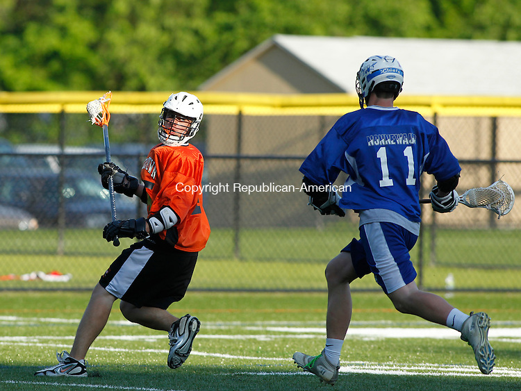 Waterbury, CT-18 May 2012-051812CM09- Watertown's Nick Massaro looks for an open man during lacrosse action against Watertown Friday night at Post University in Waterbury.  Moving in to defend is Nonnewaug's MacLain Kearns (11).   The game was held to help promote the sport throughout the Waterbury area.      Christopher Massa Republican-American