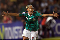 Maribel Dominguez of Mexico celebrates during the semifinal match of CONCACAF Women's World Cup Qualifying tournament held at Estadio Quintana Roo in Cancun, Mexico. Mexico 2, USA 1.