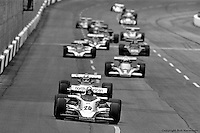 HAMPTON, GA - APRIL 22: Gordon Johncock (#20 Penske PC6/Cosworth TC) leads Johnny Rutherford and others during the Gould Twin Dixie 125 event on April 22, 1979, at Atlanta International Raceway near Hampton, Georgia.