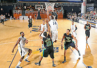 Florida International University guard DeJuan Wright (14) plays against Coastal Carolina University.  FIU won the game 64-62 on November 26, 2011 at Miami, Florida. .