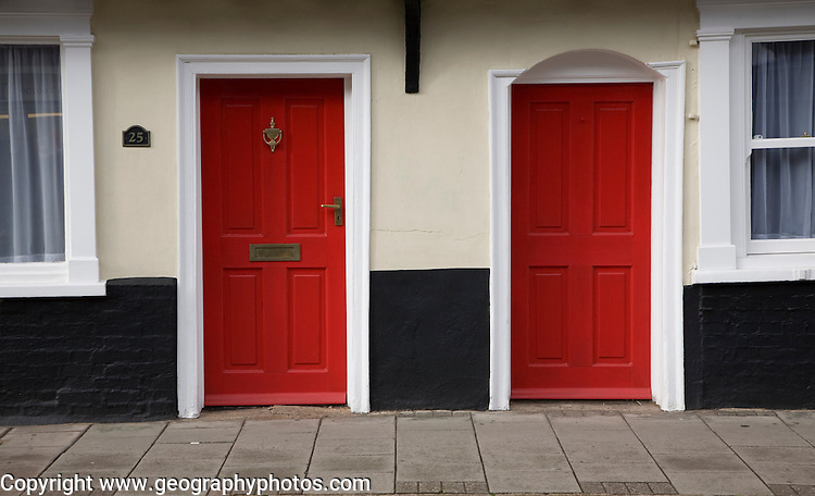 Two red painted doors in historic building, Bury St Edmunds, Suffolk, England