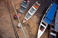 Small cargo boats tie up along the beach of the Rio Negro in Manaus, Brazil, Friday, Jan. 6, 2006. With few roads leading to the outside world, most goods are brought to the city 1,000 miles inland from the coast by boat. (Kevin Moloney for the New York Times)