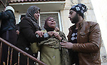 Relatives of Palestinian Jihad Khalil, who according to the Israeli police was shot and killed by an Israeli security guard after Khalil tried to stab him last November, mourn during his funeral after Israel released his body, in the West Bank village of Beit Wazan near Nablus December 24, 2016. Photo by Nedal Eshtayah