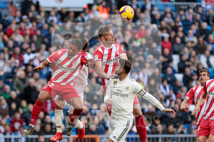 Real Madrid's Sergio Ramos and Girona FC's Douglas Luiz during La Liga match between Real Madrid and Girona FC at Santiago Bernabeu Stadium in Madrid, Spain. February 17, 2019. (ALTERPHOTOS/A. Perez Meca)