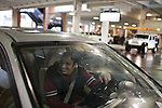 December 16, 2010. Raleigh, NC.. TP Mishra waits for his wife at the shopping mall where she works. He will then drop her off at her second job in food service. Mr. Mishra has been driving for just over a month and that has been a big change from life in NYC to life in North Carolina.. TP Mishra, a refugee from Bhutan, has recently relocated from the Bronx to Raleigh, where he lives in an suburban apartment  with his wife, as well as another Bhutanese couple.