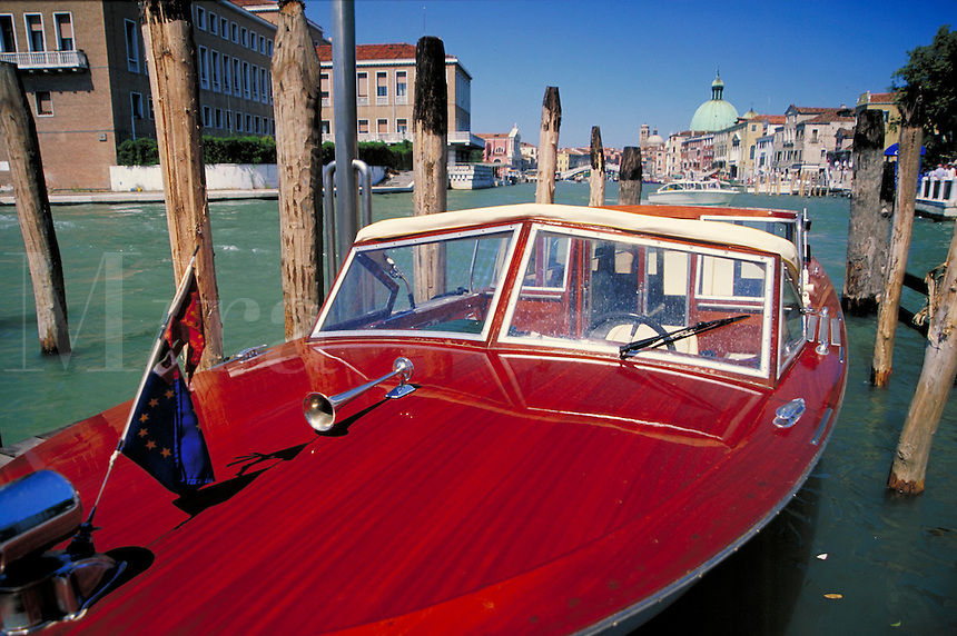 Beautiful wooden boat on the canals in Venice, Italy. boats, transportation, cityscape, waterways. Venice, Italy.