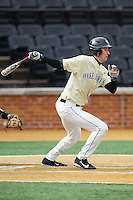 Evan Stephens (5) of the Wake Forest Demon Deacons follows through on his swing against the Marshall Thundering Herd at Wake Forest Baseball Park on February 17, 2014 in Winston-Salem, North Carolina.  The Demon Deacons defeated the Thundering Herd 4-3.  (Brian Westerholt/Four Seam Images)