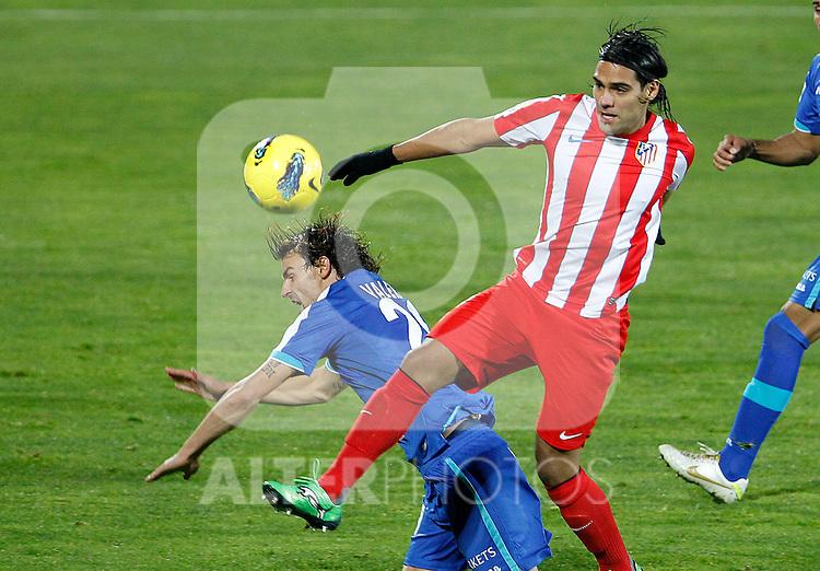 Getafe's Juan Valera (l) and Atletico de Madrid's Radamel Falcao during La Liga match.November 6,2011. (ALTERPHOTOS/Acero)