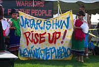 NEW YORK, USA - October 13: Indigenous people from Ecuador hold a banner as they gather during the fifth annual Indigenous Peoples Celebration on Randall's Island on October 13, 2019 in New York. Hundreds of indigenous gather together for demanding the stop killing of their people in Ecuador and the growing call for greater environmental awareness. (Photo by Kena Betancur/VIEWpress)