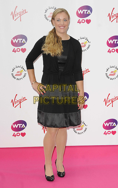 Angelique Kerber<br /> attended the WTA Pre-Wimbledon Party, Kensington Roof Gardens, Kensington High St., London, England, UK, 20th June 2013.<br /> full length black dress cardigan hand on hip <br /> CAP/CAN<br /> &copy;Can Nguyen/Capital Pictures