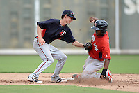Minnesota Twins shortstop Ryan Walker (12) tags Manuel Margot sliding in during an Instructional League game against the Boston Red Sox on September 26, 2014 at jetBlue Park at Fenway South in Fort Myers, Florida.  (Mike Janes/Four Seam Images)