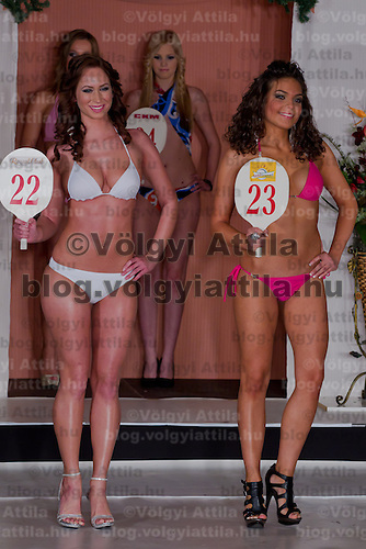 Jenifer Illyes (L) and Anita Greta Cserven (R) participate the Miss Hungary beauty contest held in Budapest, Hungary on December 29, 2011. ATTILA VOLGYI